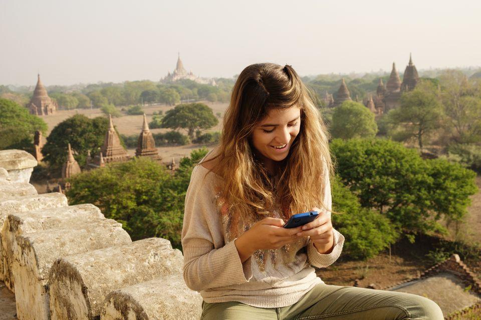 Myanmar tourist using smartphone in Bagan