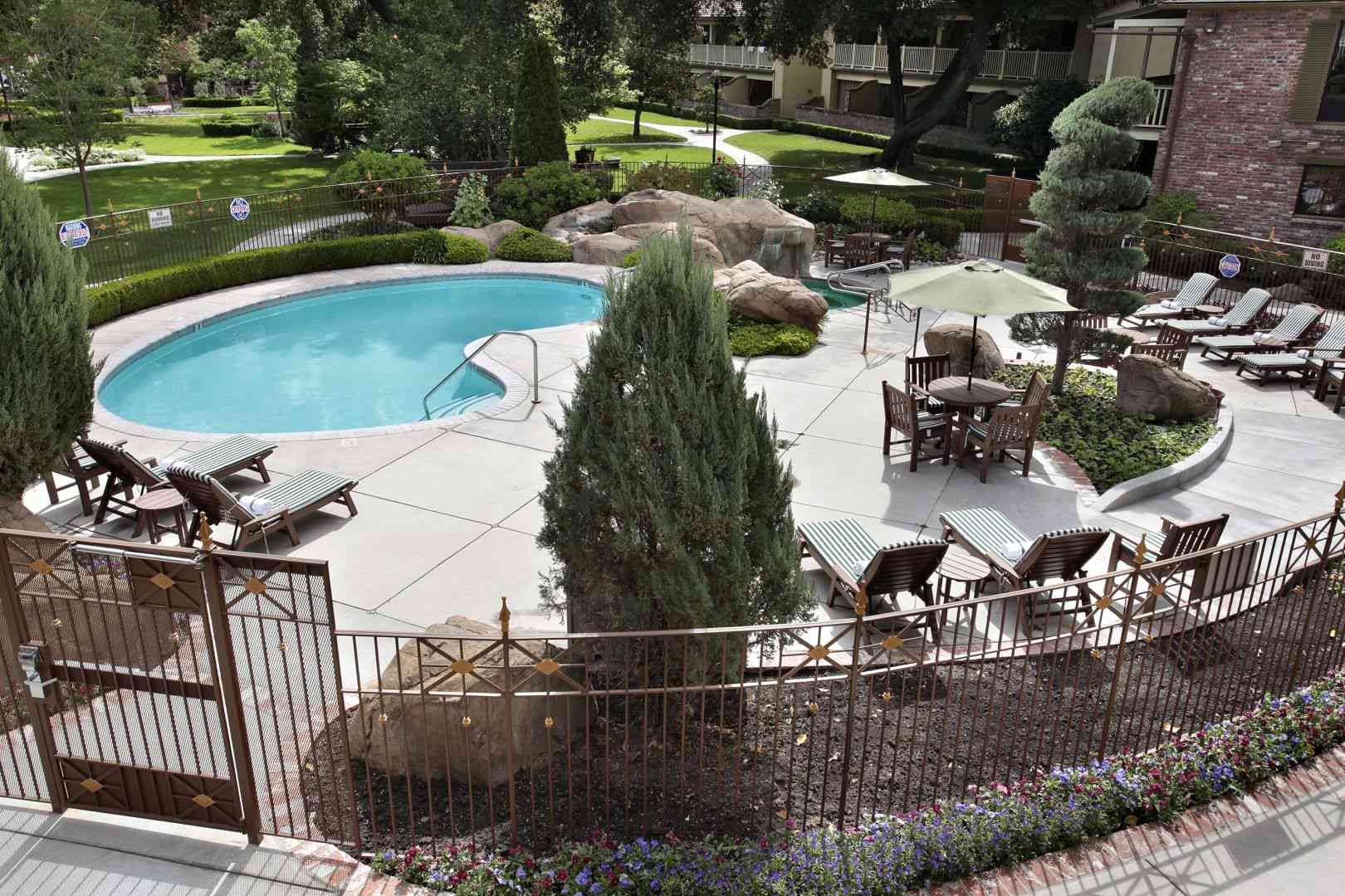 gated pool and deck with lounge chair