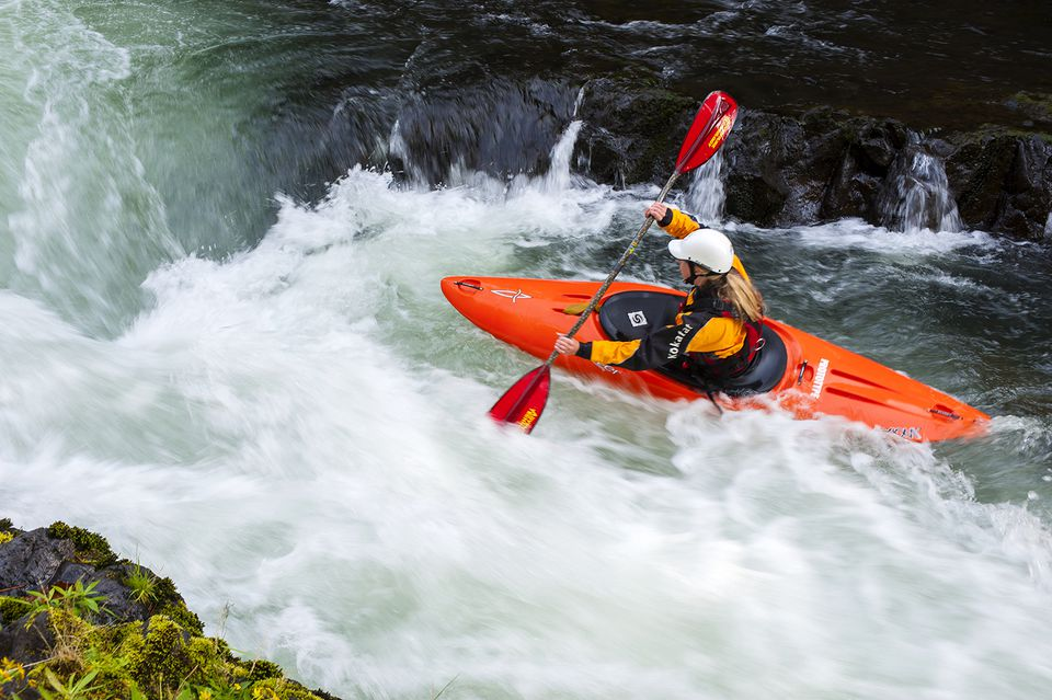 Female kayaking in the river