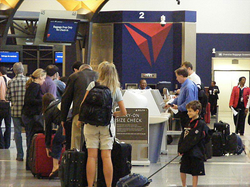 Passengers checking in at Delta desk
