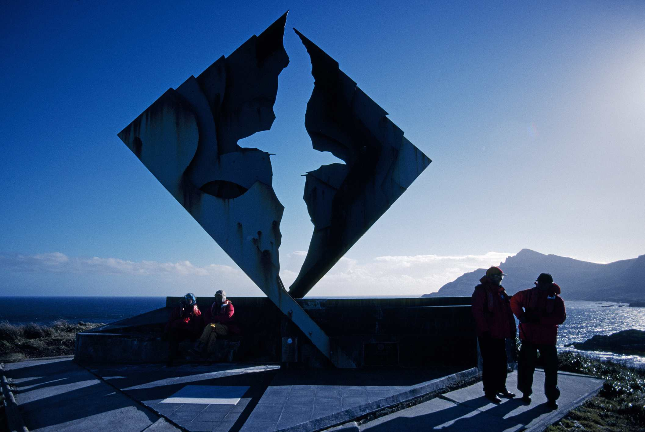 Chile, Woolaston Islands, Cape Horn. Cruise vessel tourists visiting Albatross memorial for lost mariners