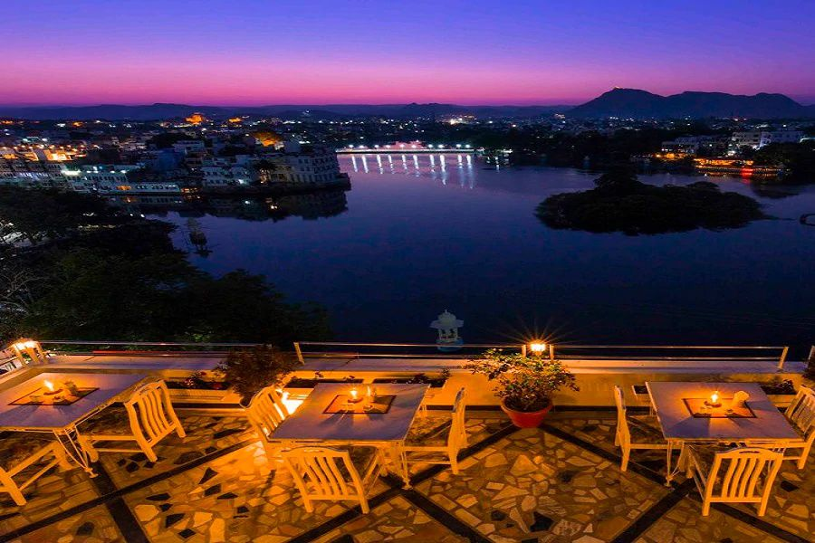 Restaurant patio overlooking the city of Udaipur at night