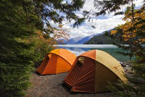 Two tents by lake during Fall