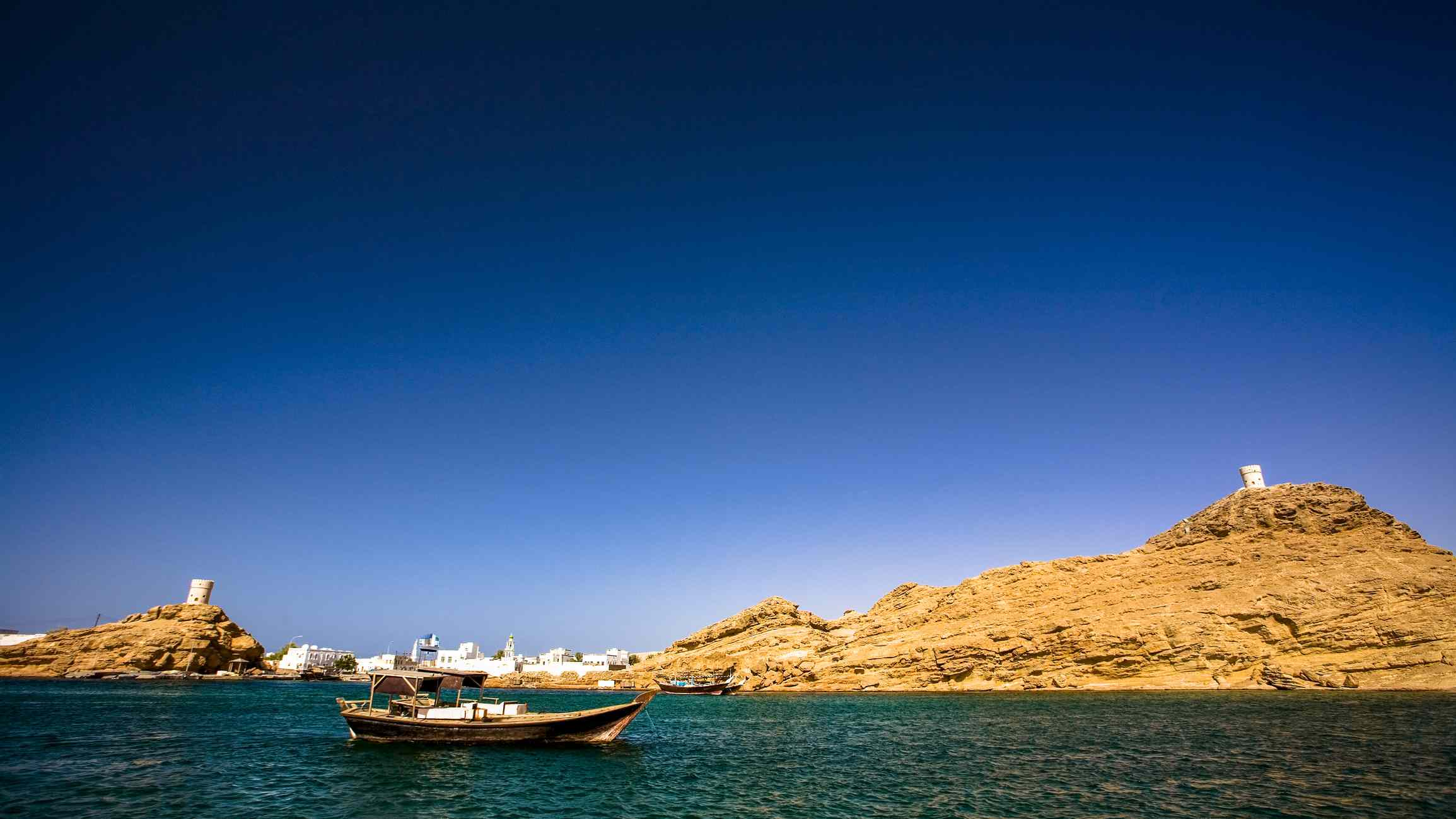 Wooden boat in the water at Sur, Oman