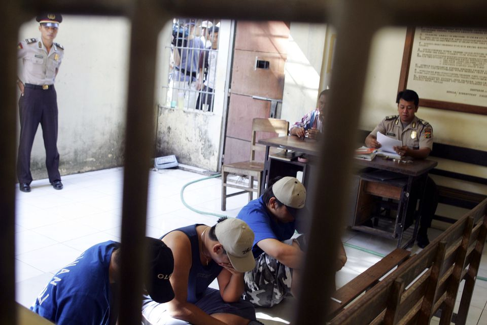 Australian citizens sit on a jail floor in Denpasar, Bali, Indonesia.