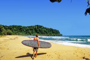 Surfer at Caribbean beach