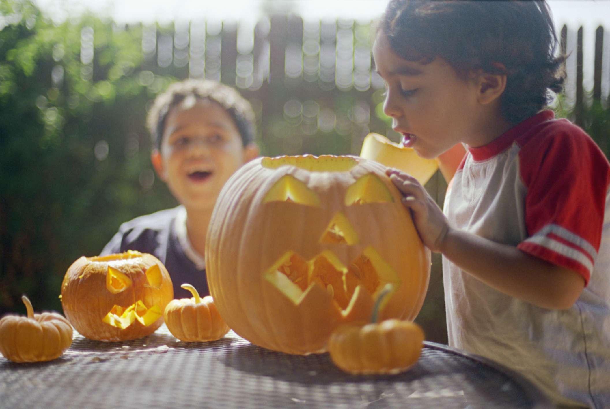 Kids decorating pumpkins