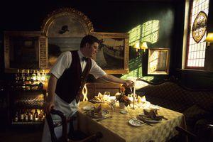 Waiter lighting candle in Denmark restaurant