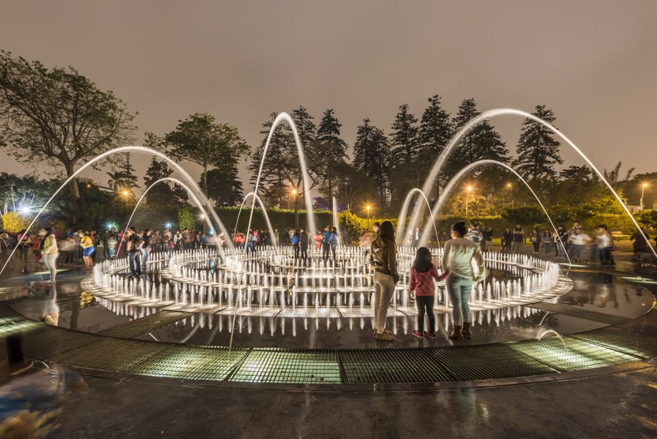 People waiting for the water at the Park of the Reserve, The Magic Water Circuit in Lima, Peru