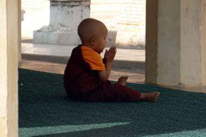 Young boy in monk's robe in Bagan, Myanmar