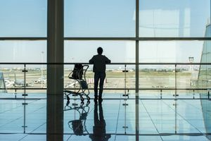 Silhouette of traveller at Barcelona Airport; Barcelona, Spain