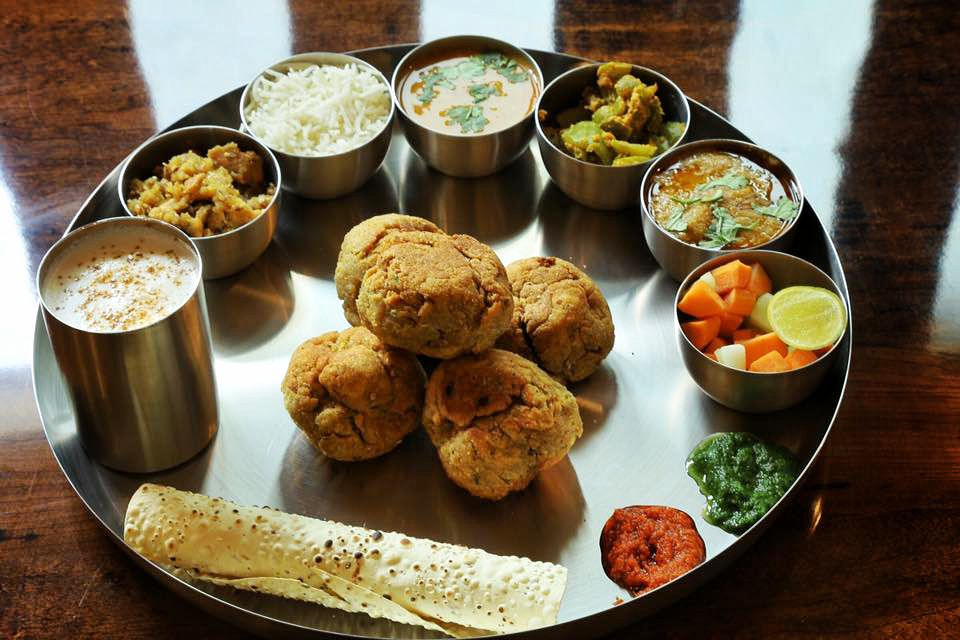 Indian platter (thali) with small bowls of sauces, vegetables, and rice