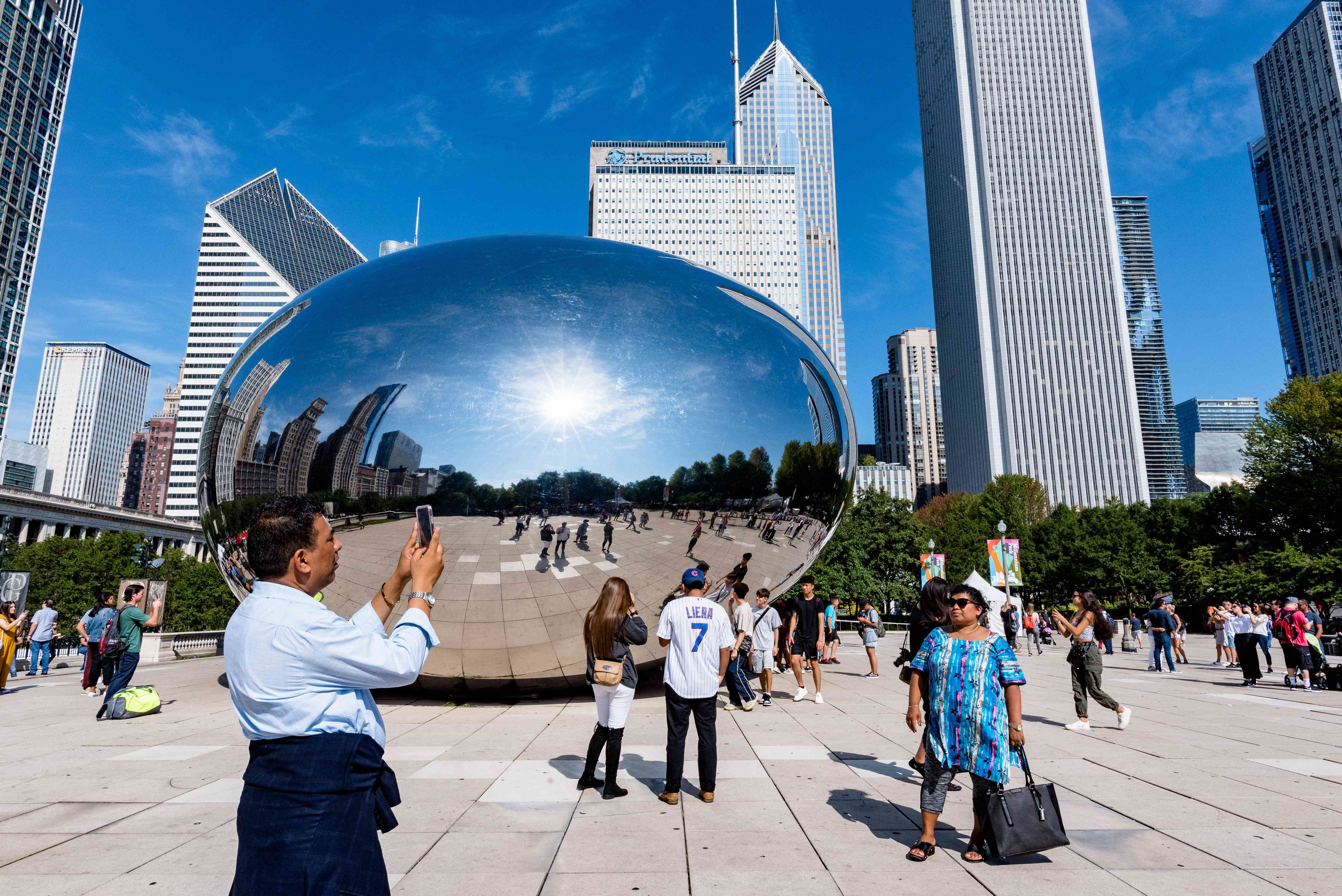 People taking photos in front of cloud gate