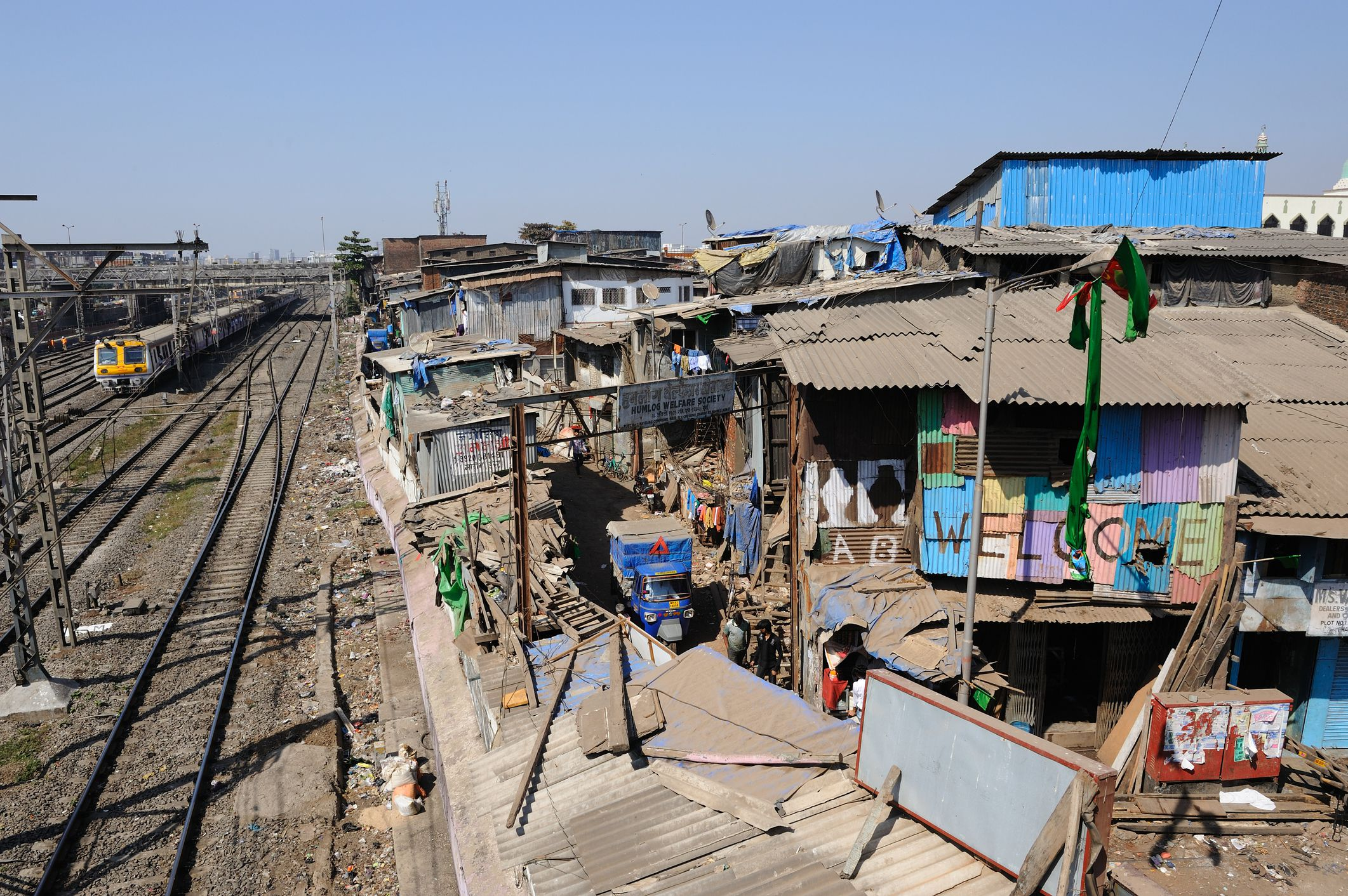 Dharavi is bordered by the railiway line in Mumbai.