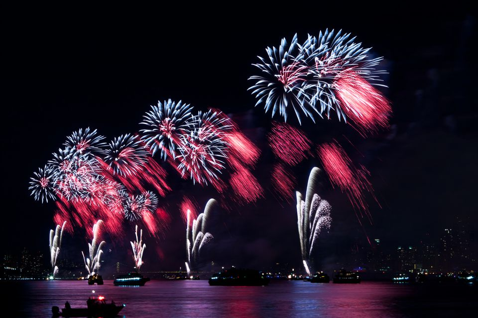 Macy's Independence Day fireworks above the Hudson River observed from Hoboken, New Jersey.