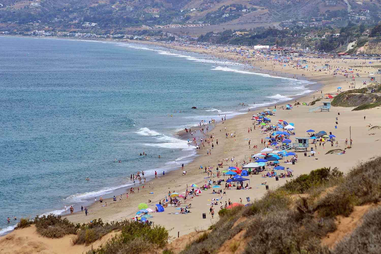 People on the beach at Zuma Beach in California