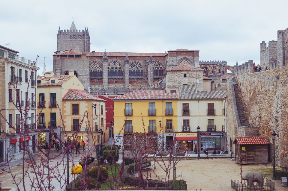 View of 'Adolfo Suárez' square in Avila with the cathedral with the cathedral in the background and views of the citywall