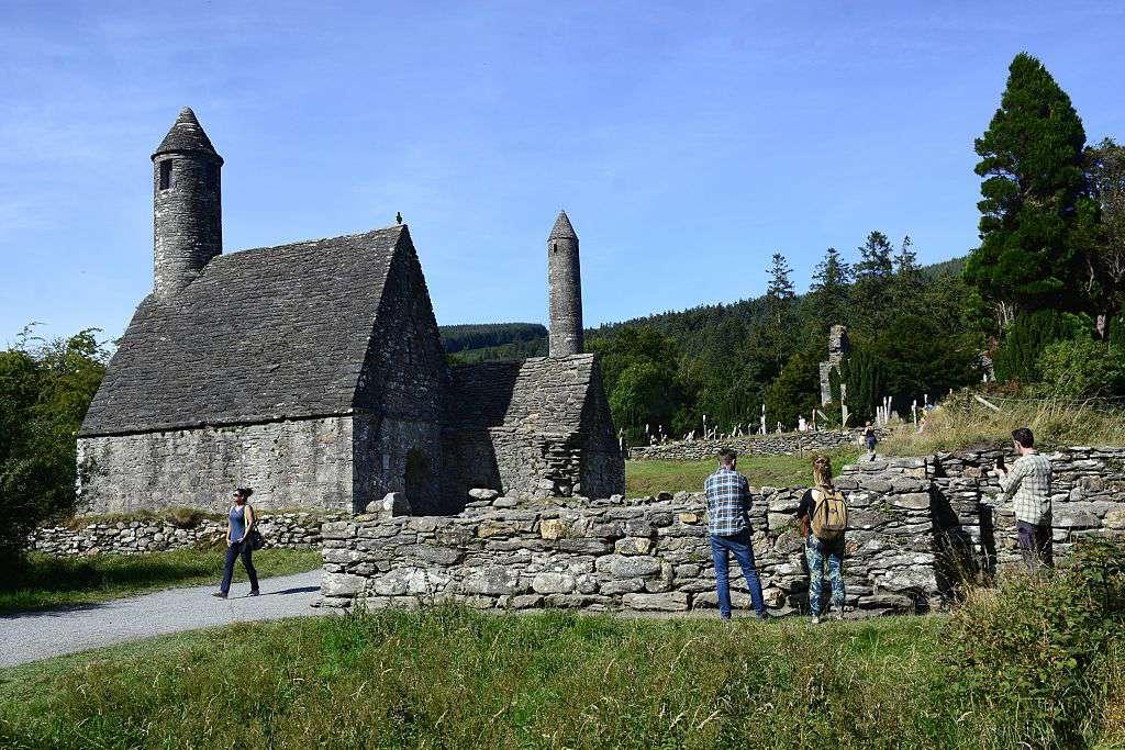 Visitors at Saint Kevin's Kitchen in Glendalough, Ireland