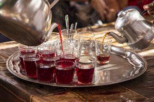 Serving hibiscus tea, Egypt