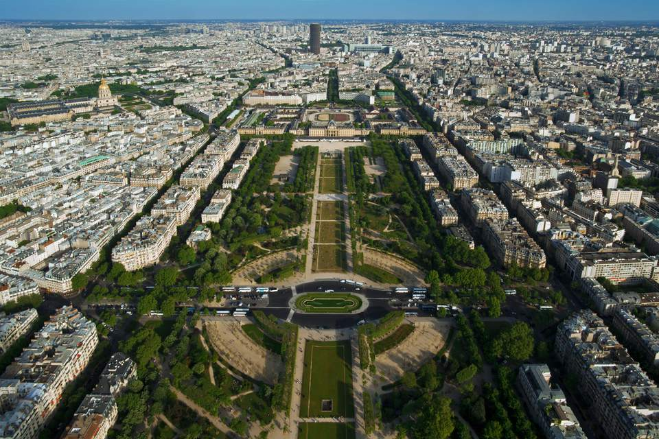 The Champs de Mars is a vast green space in Paris, close to the Eiffel Tower.