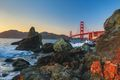 Golden Gate Bridge seen from rocks st dusk, San Francisco
