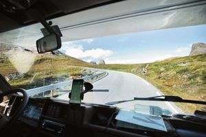 View through the windshield of an RV driving over a mountain road