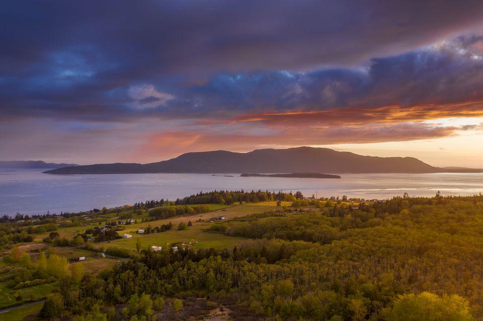 Dramatic Aerial Sunset View of Orcas Island, Washington.