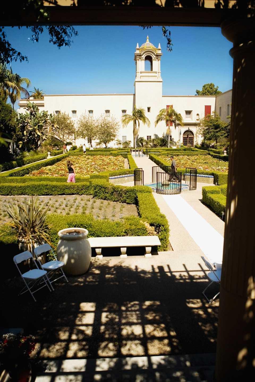 Panoramic view of the facade of an ethnic building, Alcazar Garden, Balboa Park, San Diego, California