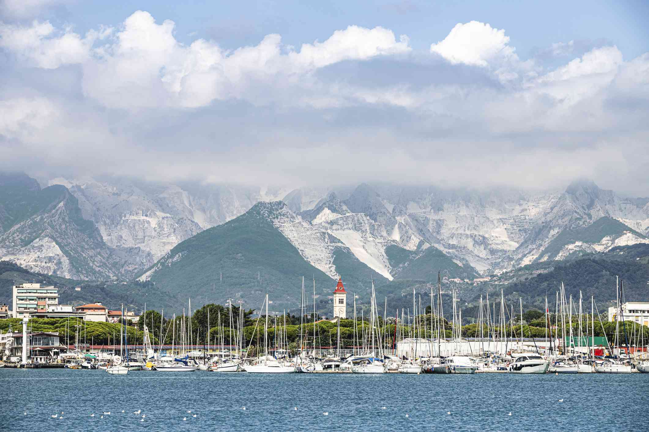 View of the shoreline at Marina di Carrara with marble quarries in the background
