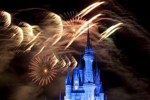 Crowds and Magic Kingdom castle during nightly fireworks, Disney World.