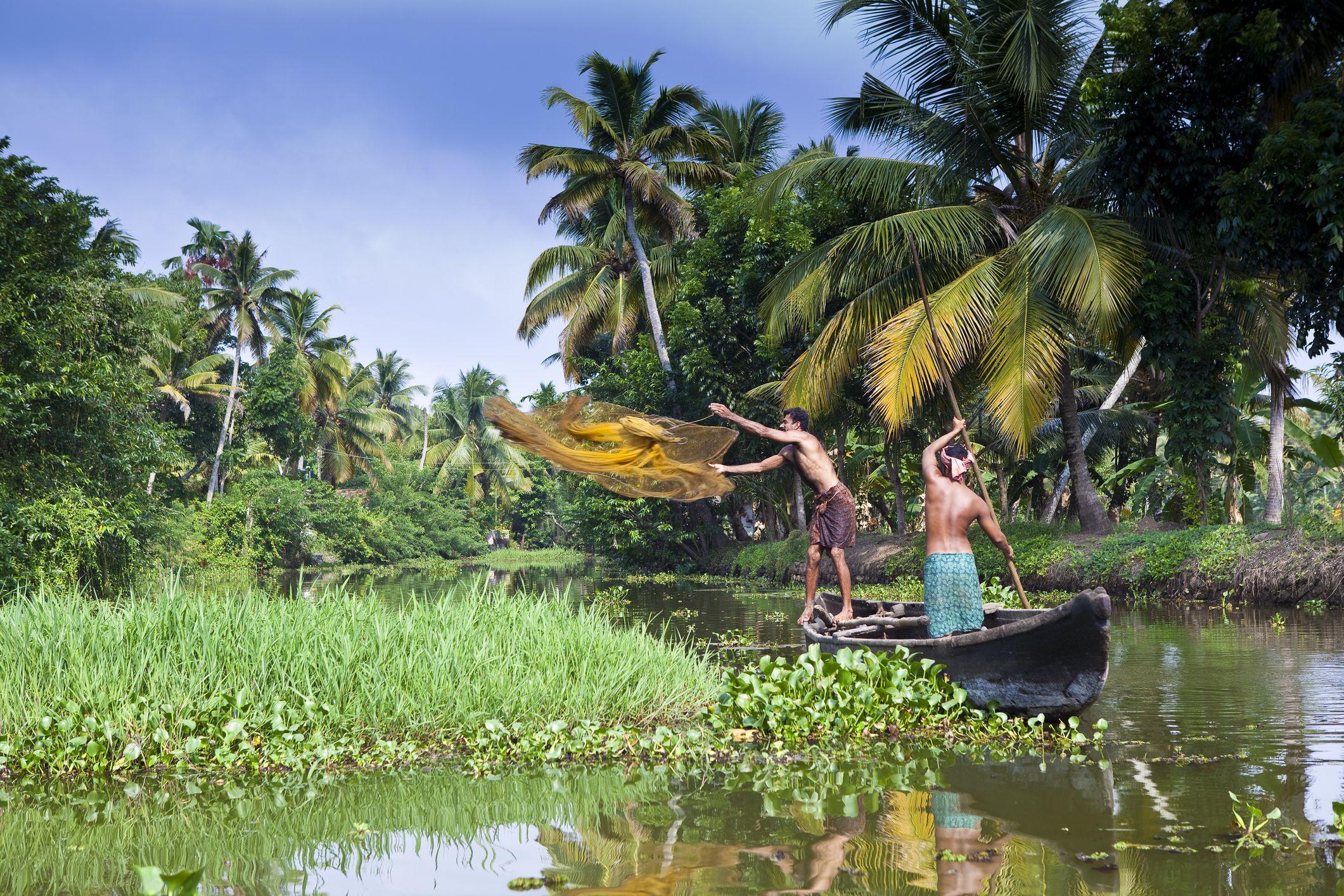 Villagers fishing in backwater canals around Kumarakom