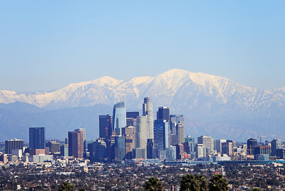 Snowcapped mountain as background of downtown Los Angeles