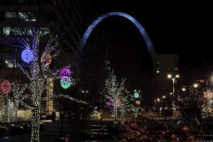 Christmas lights in front of the St. Louis Arch