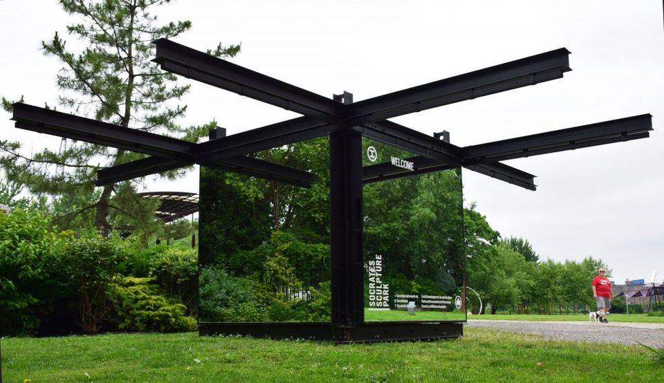 Mirrored cube in Socrates Sculpture Park reflecting the trees and greenery