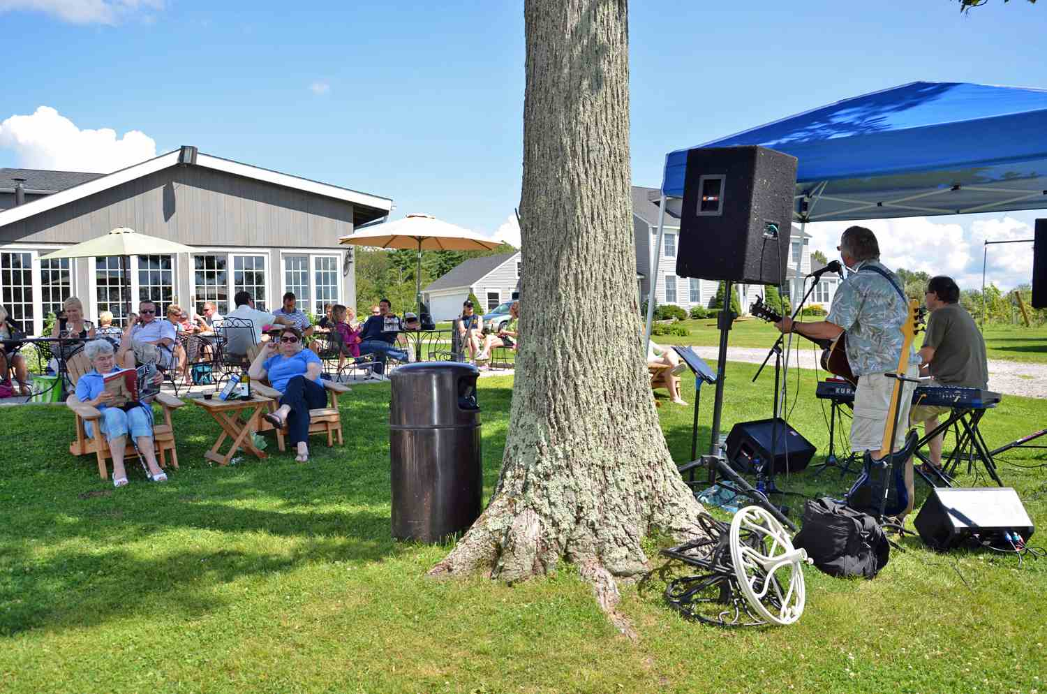 People relaxing while a band plays at Sunset Meadow Vineyard, CT