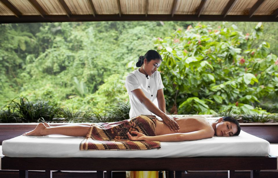 Woman receiving a massage at a spa.