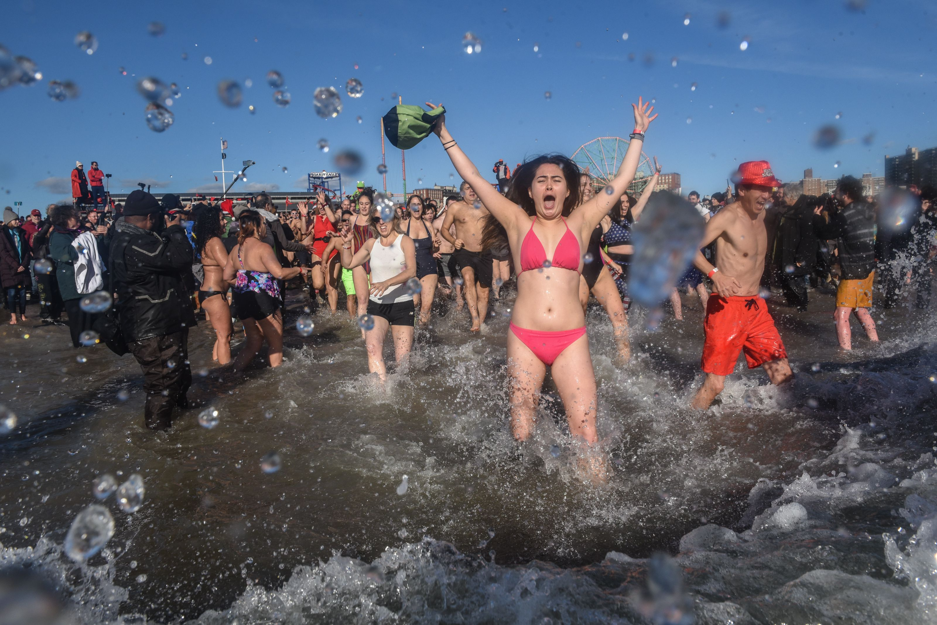 Scores Of Swimmers Take Icy Plunge At Annual Coney Island Polar Bear Club Swim