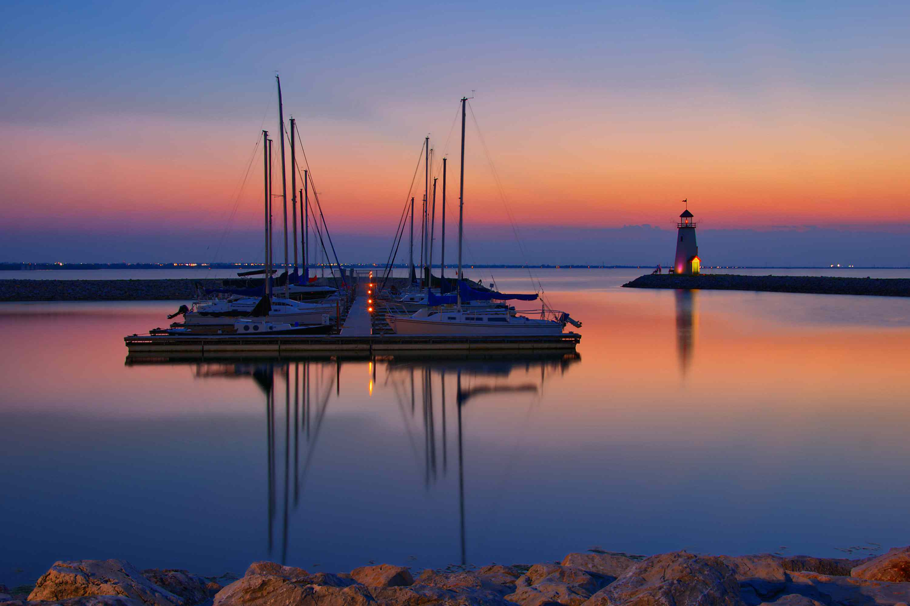 Lake Hefner with boats at sunset lighthouse in background, Oklahoma City.