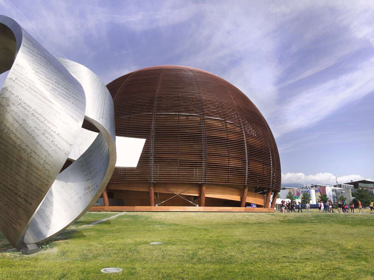 Exterior of CERN with round building and silver sculpture