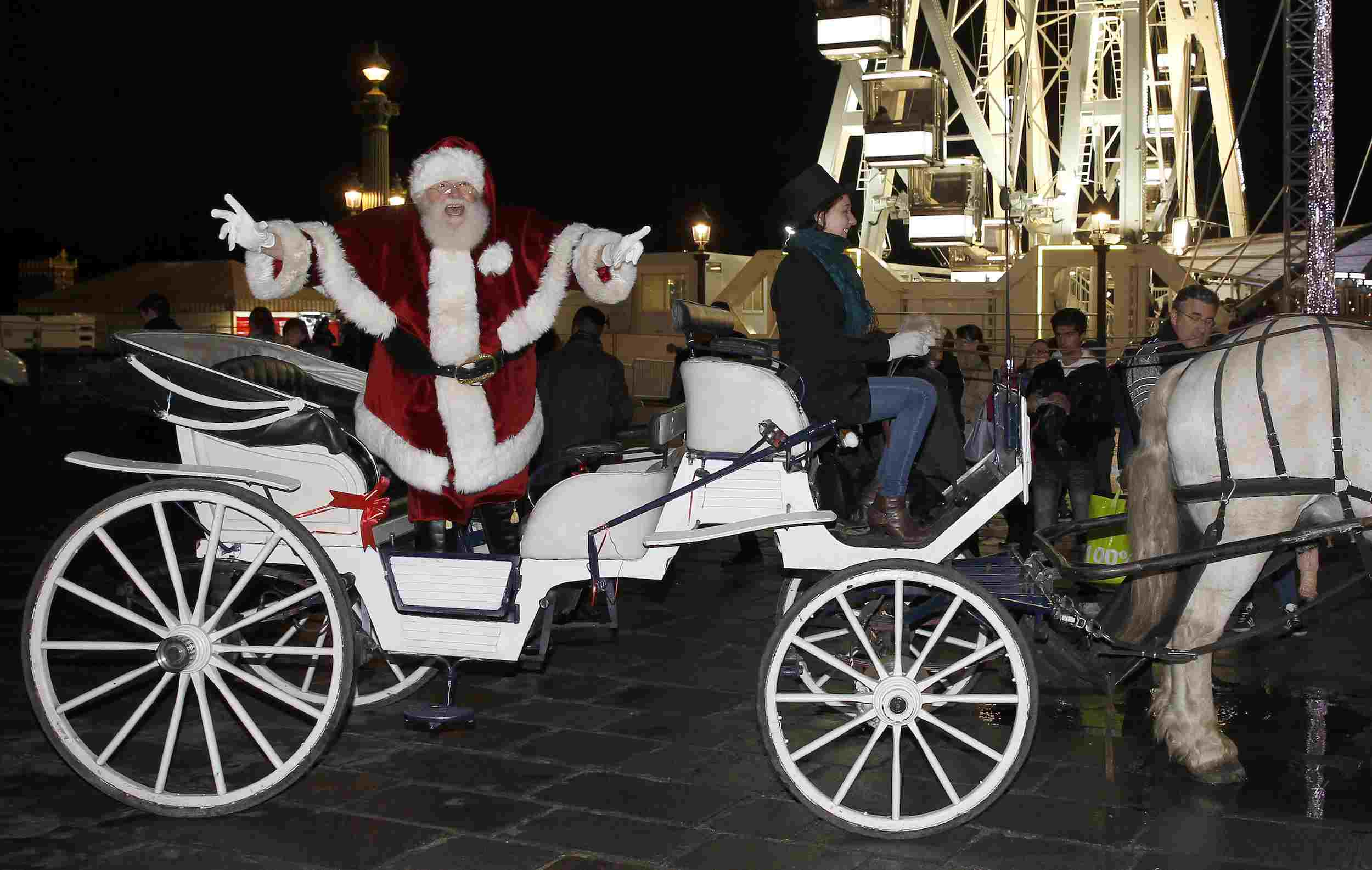 Santa and his horse-drawn carriage in Paris, France in 2014
