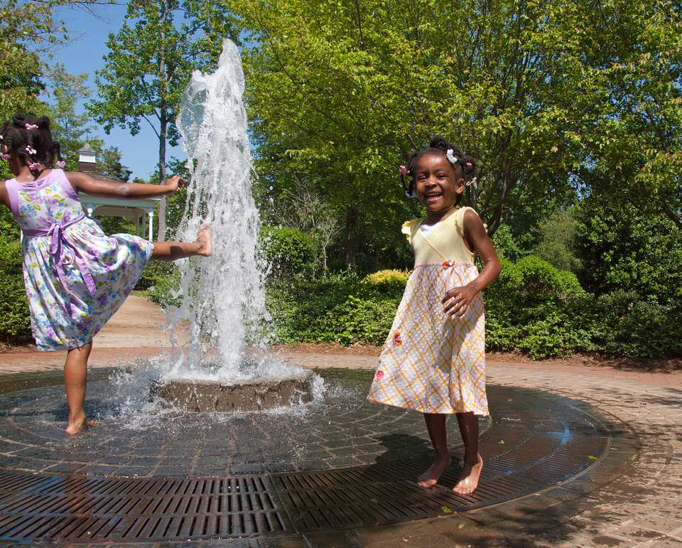 Girls playing in fountain in Charlotte NC