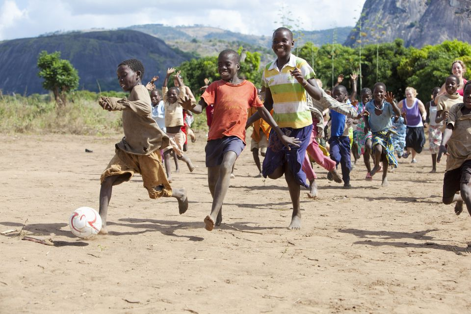 African children playing soccer in a rural village, Mozambique