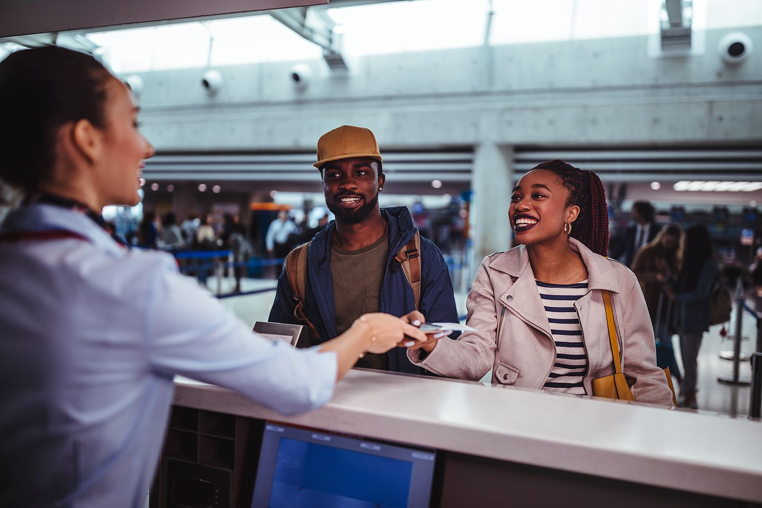 Young passengers doing check-in for flight at airport