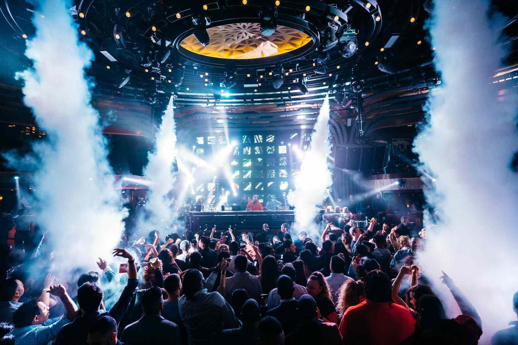 Crowd in Jewel nightclub with smoke machines and a light show