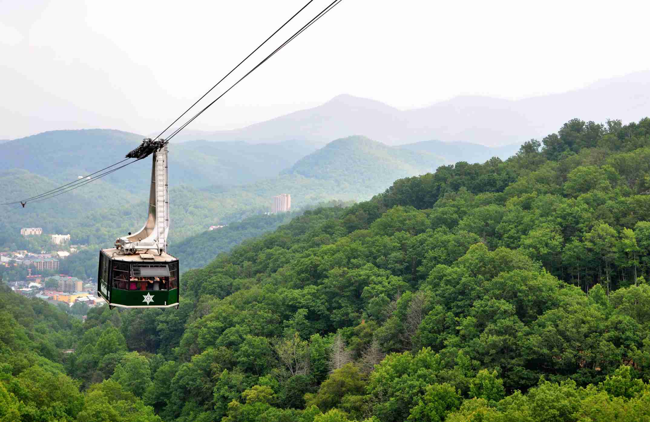 Tourists riding the scenic gondola cable car at Ober Gatlinburg in Tennessee
