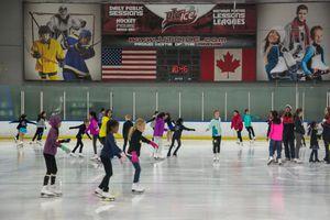 Interior shot of kids skating at UTC Ice Sports Center
