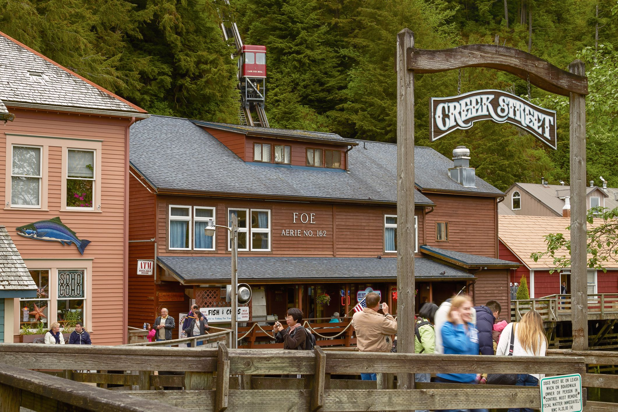 People Enjoying Visit of Creek Street in Ketchikan Alaska