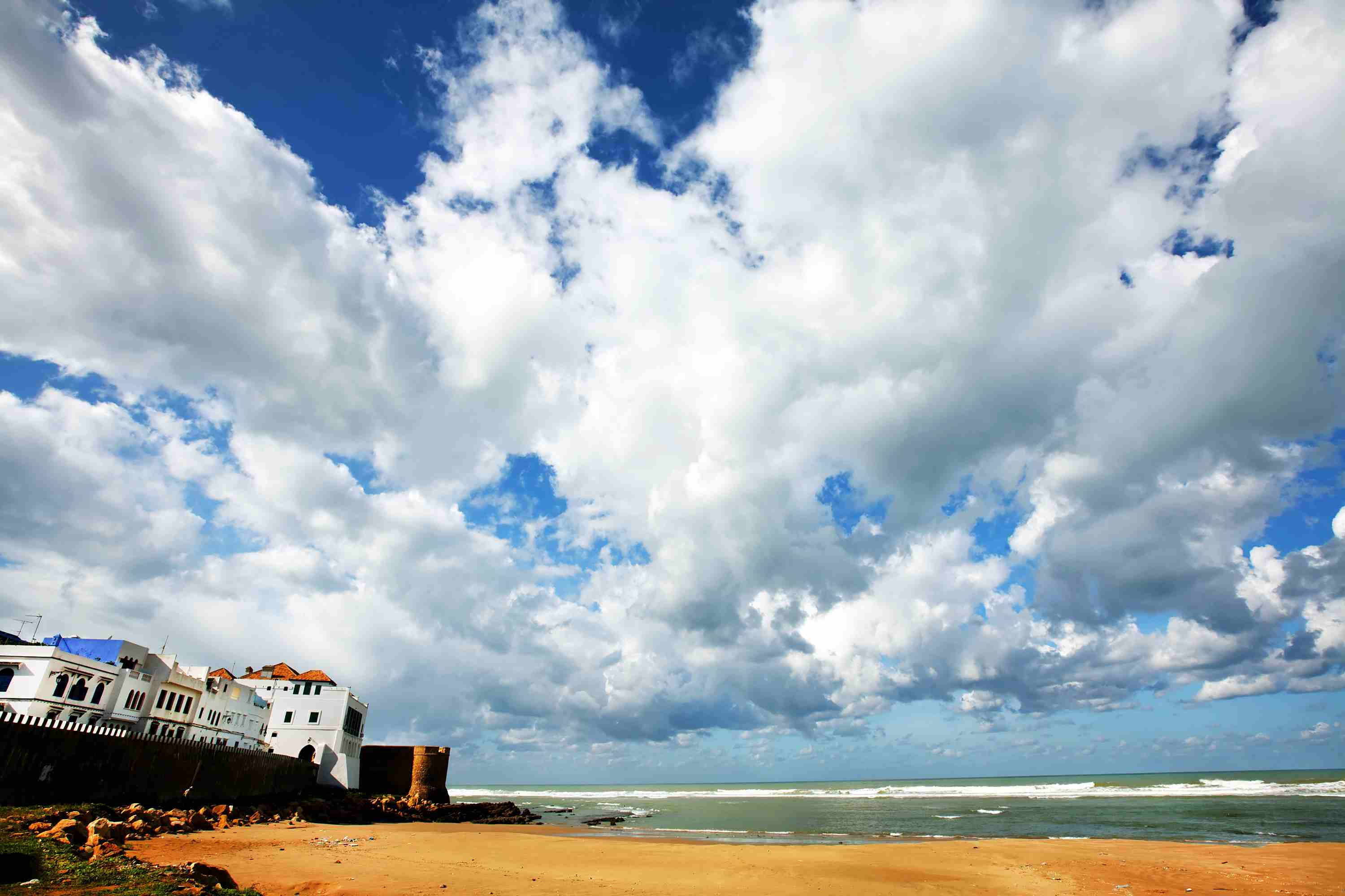 Scenic View Of Beach Against Cloudy Sky At Asilah