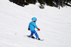 Little child skiing down hill
