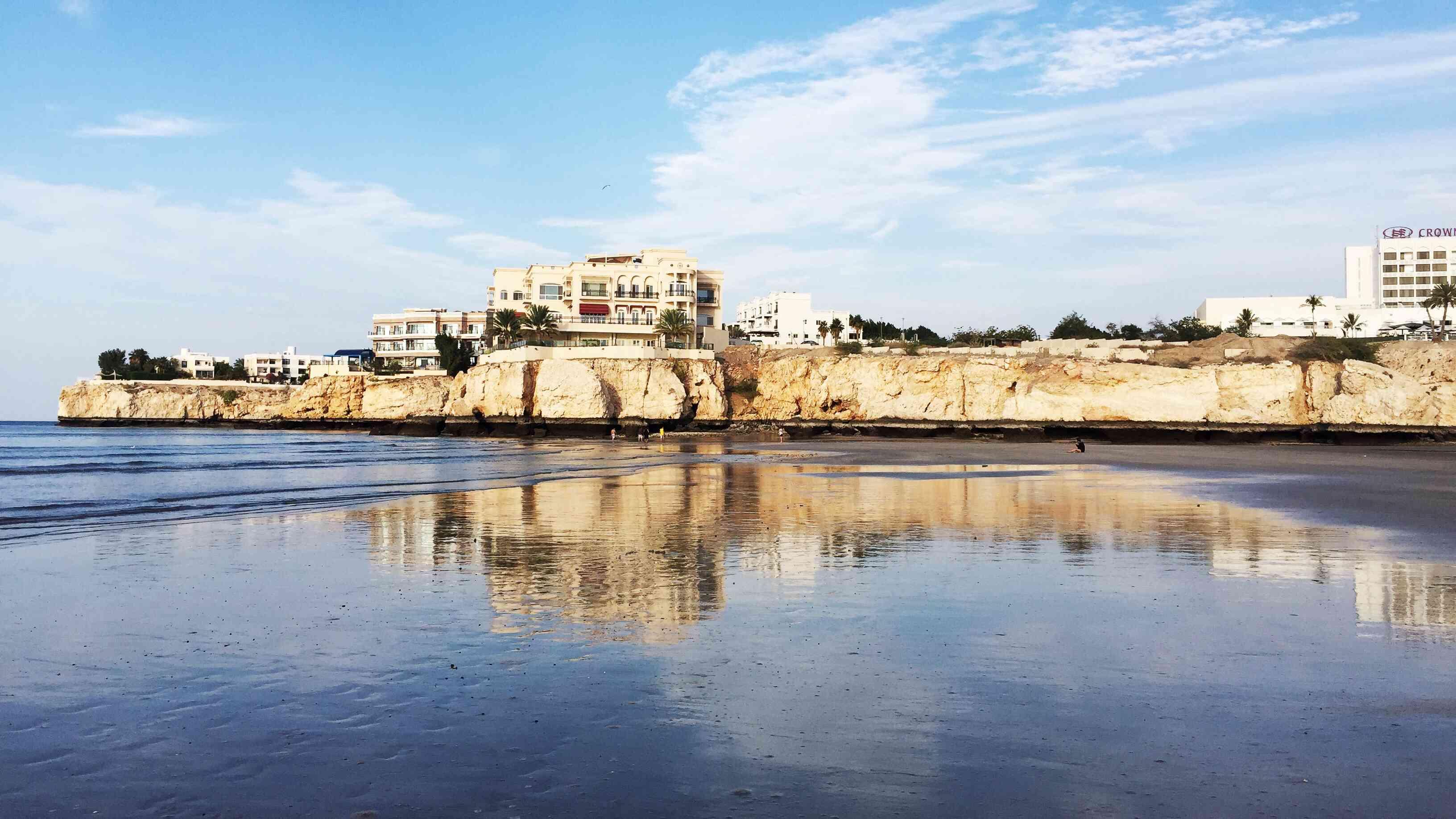Reflection in water at Al Qurum Beach